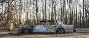Car Burned by Wildfire, East Bastrop, Texas, USA by Carolyn Monastra