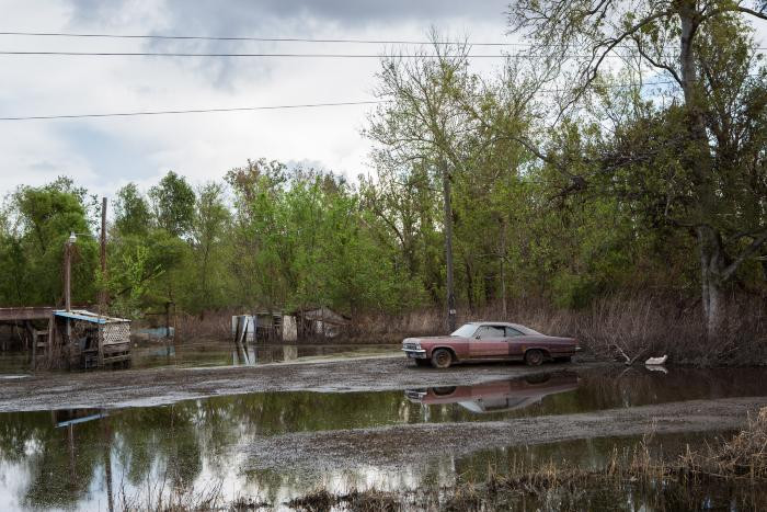 Old Red Car in Flooded Yard, Braithwaite, Louisiana by Carolyn Monastra