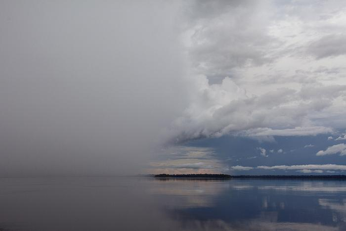 Storm brewing over the Rio Negro, Amazon, Brazil by Carolyn Monastra